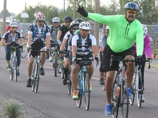 Cyclists start off on the 25-mile race during the third