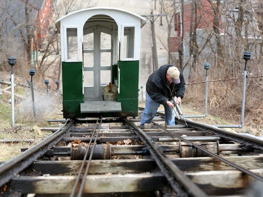 Steve Schadle greases the tracks on the Fourth Street