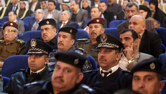 Members of the Iraqi army listen to a speech by Iraqi Prime Minister Nouri al-Maliki.