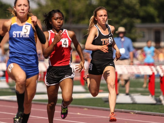 Jodi Lipp of St. Cloud Tech runs in the 100-meter finals Saturday, June 10, during state track and field competition at Hamline University in St. Paul.