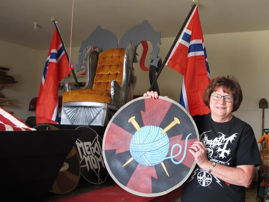 Jeanne Prueher holds up her favorite shield, one of
