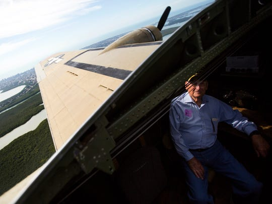 """Vernon """"Bo"""" Sigo, 92, sits in the radio room of a Boeing B-17 Flying Fortress during a flight from Marathon, Fla. to the Naples Municipal Airport in East Naples on Thursday, February 2. This was the first time Sigo stepped foot on a B-17 since he came home from war on October 4, 1945. Sigo was a navigator in the 49th bomb squadron in the second bomb group."""