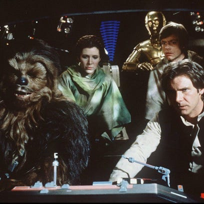 Chewbacca (Peter Mayhew, left), Princess Leia (Carrie