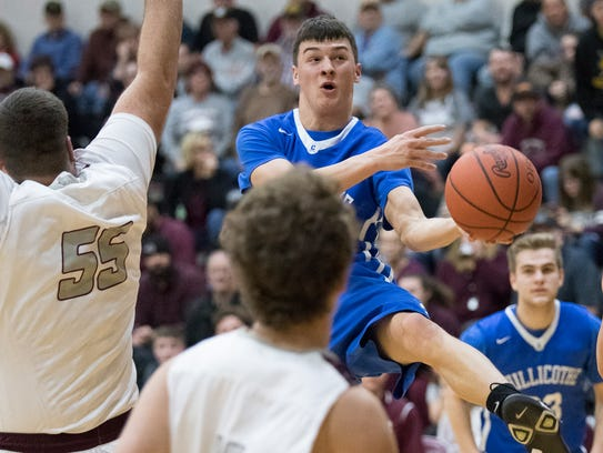 Chillicothe's Simon Roderick flies to the hoop during