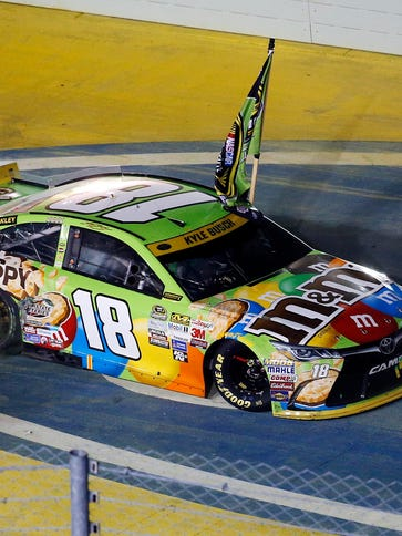 Kyle Busch celebrates his first career Sprint Cup championship.