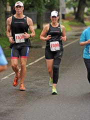 Sean Alexander and his wife Colleen Kelly Alexander, are competing in the HITS Triathlon in Naples this weekend, a little more than five years after Kelly Alexander was nearly killed when she was run over by a freight truck while biking near her home in Connecticut.