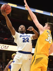 All-Greater Rochester Player of the Year in 2014, Dontay Caruthers (22) is a junior guard at the University at Buffalo. The 13th-seeded and MAC champion Bulls play Pac-12 champion Arizona, a No. 4 seed, in their South Region opener on Thursday at about 9:40 p.m. from Boise, Idaho.