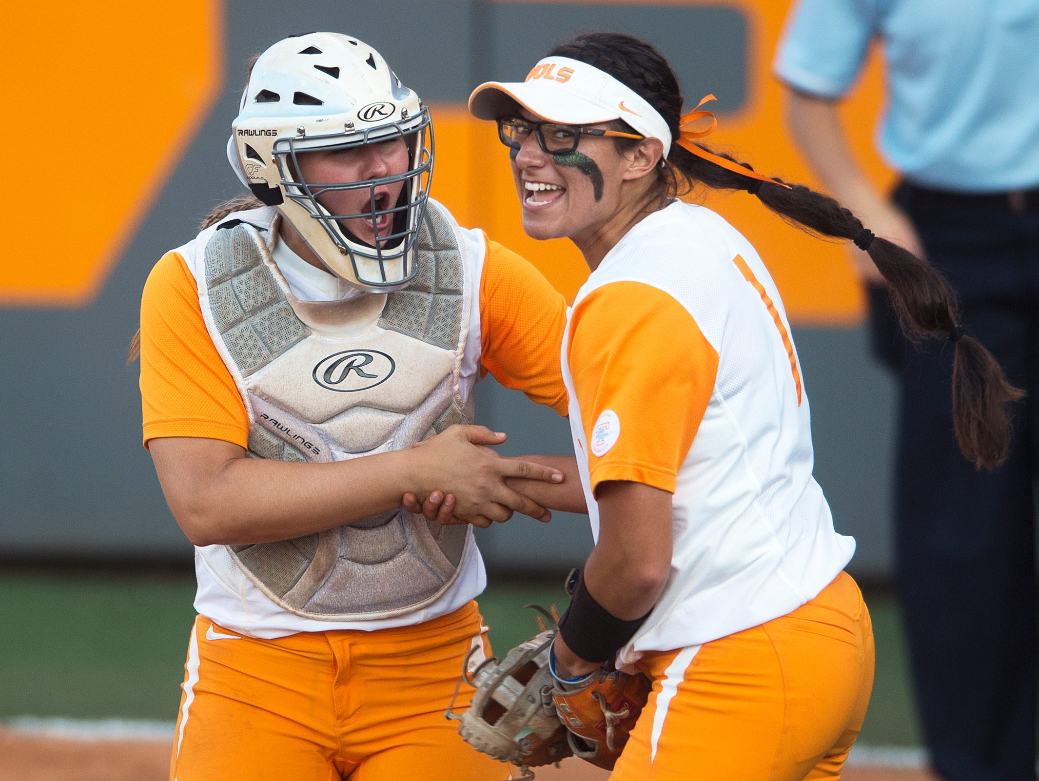 At left Tennessee's Abby Lockman (44) and Tennessee's Matty Moss (1) celebrate at the end of an inning during an NCAA Super Regional game between Tennessee and Texas A&M at Sherri Parker Lee Stadium on Friday, May 26, 2017. Tennessee defeated Texas A&M 8-1.