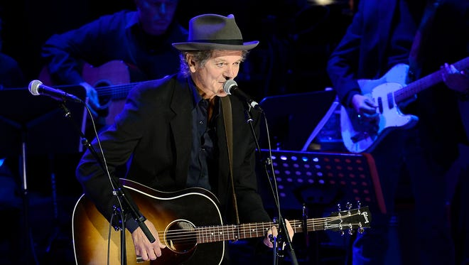 """Rodney Crowell performs """"Detroit City"""" while honoring Country Music Hall of Fame inductee Bobby Bare at a ceremony Oct. 27, 2013, in Nashville."""