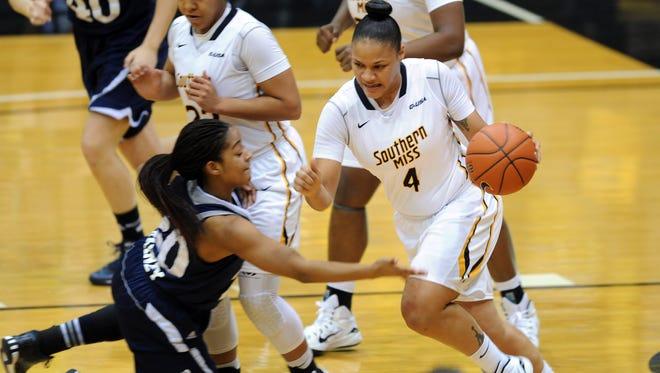 Southern Miss senior Tamara Jones dribbles past Rice's Shani Rainey in Thursday's women's basketball game at Reed Green Coliseum.