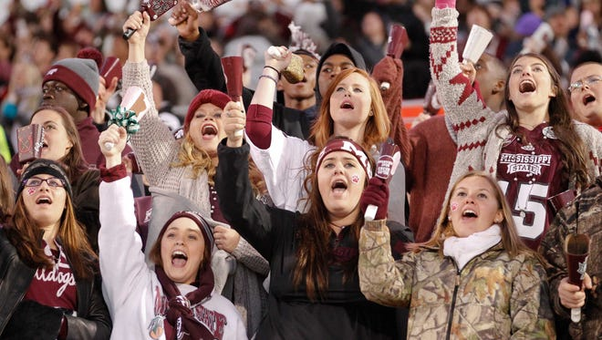 Mississippi State Bulldogs fans ring their cowbells during the game against the Arkansas Razorbacks at Davis Wade Stadium.