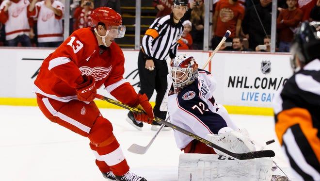 Detroit Red Wings center Pavel Datsyuk (13) scores a shoot-out goal past Columbus Blue Jackets goalie Sergei Bobrovsky at Joe Louis Arena.