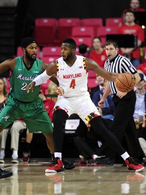 Maryland Terrapins forward Robert Carter (4) defended by Marshall Thundering Herd forward Ryan Taylor (25)