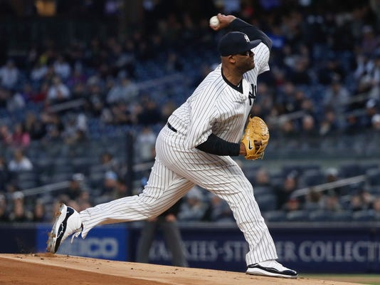 New York Yankees pitcher CC Sabathia delivers against the Baltimore Orioles during the first inning of a baseball game Friday, April 6, 2018, in New York. (AP Photo/Julie Jacobson)