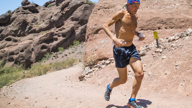 Don Solberg, 47, Phoenix, runs in Echo Canyon on Camelback Mountain, Monday, June 20, 2016.  Temperatures were expected to hover around 120 degrees.