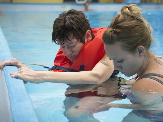 Suanne Odegard, left, and Sarah McMurray practice range of motion exercises at the Morony Natatorium as part of the swim therapy program for BeeHive Homes.