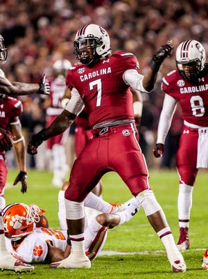 South Carolina defensive end Jadeveon Clowney, celebrating Nov. 29 after making a tackle against Clemson, says he is healthy and ready for the Capital One Bowl.