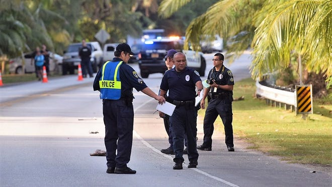 Guam Fire and Guam Police Department investigators at the scene of an auto-pedestrian accident in Agat on April 1, 2018.