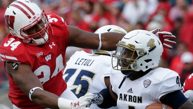 Senior defensive end Chikwe Obasih (34) has missed six games this year but has started 31 of the 42 games he's played at UW in his career.