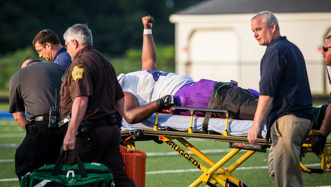 Central's DJ Pointer is carted off the field after suffering an injury during a scrimmage at Delta High School Friday, Aug. 11, 2017.