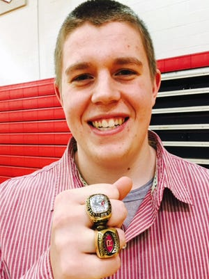 Riverheads senior Chandler Branch shows off his 2016 and 2017 state football championship rings after the presentation ceremony at Riverheads High School in Greenville, Va., on Sunday, March 18, 2018.
