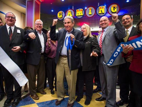 Tioga Downs Casino owner Jeff Gural, center, participates