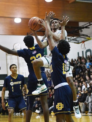 New Haven's Ronald Jeffery III cuts between Country Day's Demetriess Champion and Wendell Green in the first half of New Haven's triumph on Wednesday night.