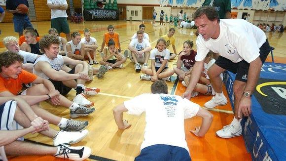Former Skyforce coach Flip Saunders teaches a basketball