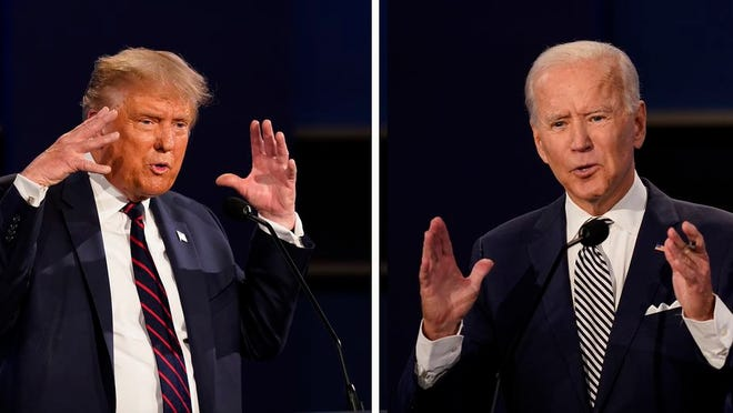 This combination of Sept. 29, 2020, file photos show President Donald Trump, left, and former Vice President Joe Biden during the first presidential debate at Case Western University and Cleveland Clinic, in Cleveland, Ohio. The Commission on Presidential Debates says the second Trump-Biden debate will be 'virtual' amid concerns about the president's COVID-19.