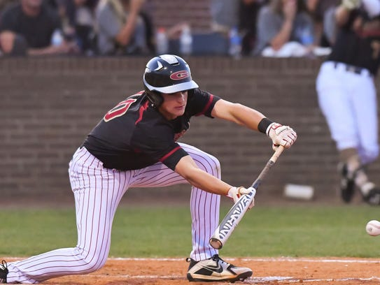 Germantown's Carson Fisher (10) lays down a bunt aginst