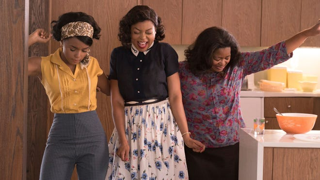 "Janelle Monae, from left, Taraji P. Henson and Octavia Spencer play mathematicians who help NASA stay in the space race in the early 1960s in ""Hidden Figures."""