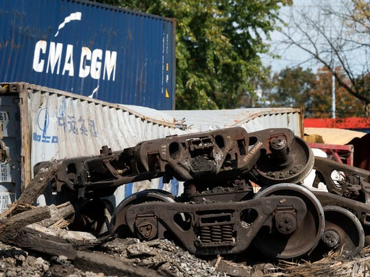 Crews from Norfolk Southern are cleaning out and repairing where one of their trains derailed at the intersection of East Inskip Drive and Fennel Road on Sunday, October 22, 2017.