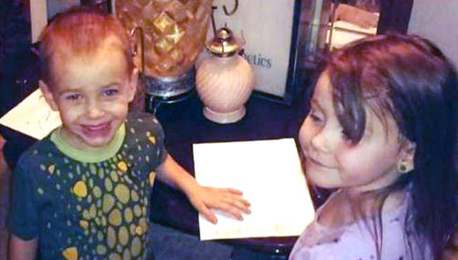 This undated photo provided by the Los Angeles County Sheriff's Department shows Brayden Watkins, 3, left, and Rylee Watkins, 5, who have gone missing along with their 2-year-old sister Joslynn Watkins. Authorities are seeking Joshua Robertson, 27, and Brittany Humphrey, 22, who they believe were involved in the killing of children's mother, Kimberly Harvill, and may have fled California with the children.