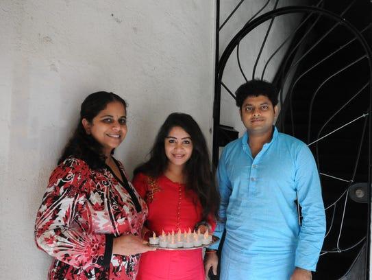 From left, Sridevi Talluri, Priya Palkolanu, and Seshu Ganta came by to invite the public to the Indus Diwali 2017, Festival of Light, this Sunday.
