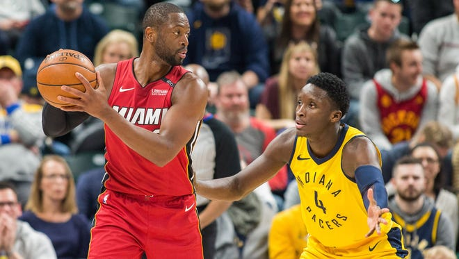 Miami Heat guard Dwyane Wade (3) looks to pass the ball against Indiana Pacers guard Victor Oladipo (4) in the second half at Bankers Life Fieldhouse.