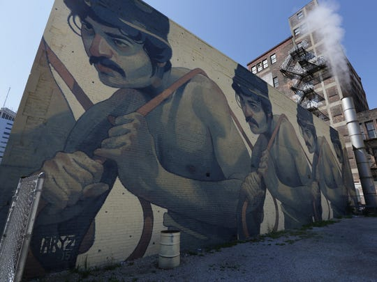 """One Man Army"" a mural by spanish artist Aryz on 25 East Grand River in Detroit on Thursday, July 16, 2015."