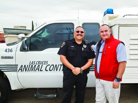 Animal Control Field Supervisor Gino Jimenez, left, and DogCruces magazine owner Vic Villalobos recently teamed up to share lost dog images on the DogCruces Facebook page, leading to some reunited pets and owners.