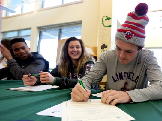 Carson Mella signs a letter of intent to play football