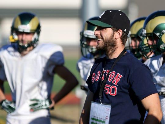 Kyle McGrath, the Regis High School football head coach,