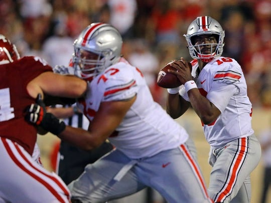 Ohio State quarterback J.T. Barrett helped lead the Buckeyes to a 49-21 win Friday, Aug. 31, 2017 in Indiana.