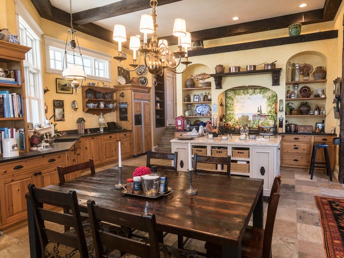 The kitchen is a large, all-purpose room with rustic