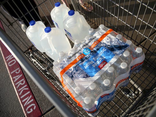 Water purchased by Loren and Linda Stratton, of Turner, following a tap water contamination warning at WinCo Foods on Lancaster in Salem on Tuesday, May 29, 2018.