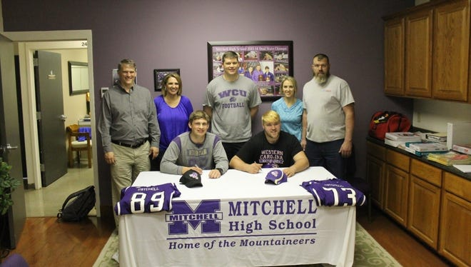 Mitchell seniors Alex McKinney, left, and Todd Self will be joining the Western Carolina University football program as preferred walk-on players.