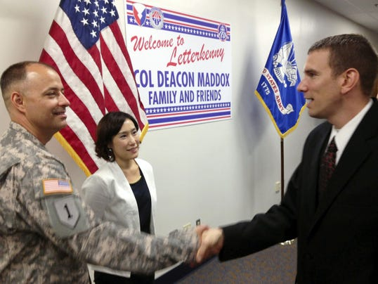 Col. Deacon Maddox, left, with his wife, Jenny, is greeted by Chambersburg Mayor Darren Brown during a reception on Friday for Col. Maddox. Maddox takes over command of Letterkenny Army Depot from  retiring Col. Victor Hagan.