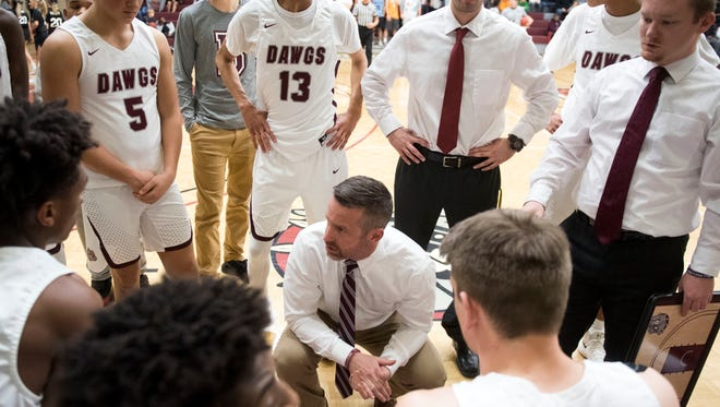 Bearden coach Jeremy Parrott talks with his team during a game against West on Jan. 9.