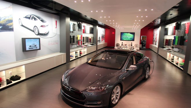 Tesla Motors used to sell its vehicles in New Jersey but was blocked roughly a year ago by the state Motor Vehicle Commission because state law requires cars to be sold through franchised dealerships. Pictured is a Tesla model S in the showroom at their store in the Short Hills Mall.