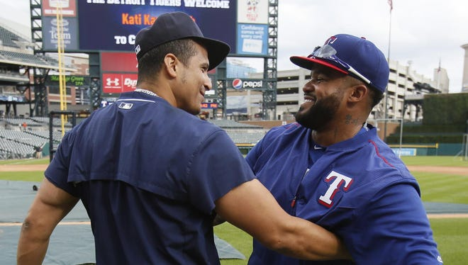 "Tigers DH Victor Martinez greets Prince Fielder, who left Detroit with a few choice words after a subpar 2013 postseason. ""It's just like going to any other place to play,"" he said of his Thursday return to Comerica Park."