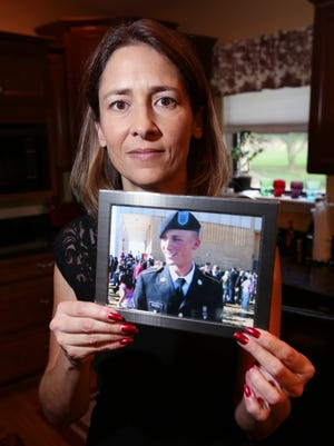 Emily Walden holds a photograph of her son T.J. who died of an overdose four years ago.  She has become involved with Fed Up to increase awareness and prevent overdoses.Aug. 23, 2016