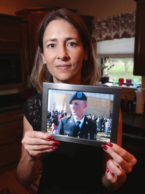 Emily Walden holds a photograph of her son T.J. who died of an overdose more than four years ago. She tries to increase awareness and prevent overdoses and traveled to Washington, D.C. to speak at the Food and Drug Administration's meeting on the reformulated version of Opana.