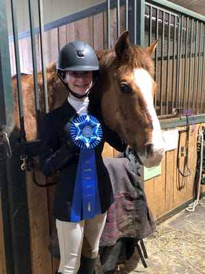 Kylie Browning of Horseheads won regional and zone championships in equestrian.